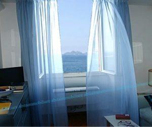 Apartment in period villa for sale with private beach